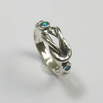 two opals and lovers knot ring