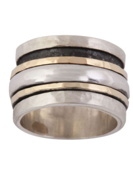 gold and silver spinner ring by Ithil-0
