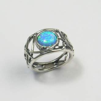 basketweave sterling ring with center opal by Tamir Zuman