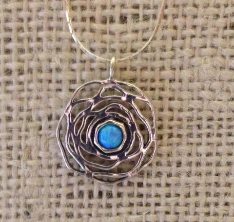 opal in sterling silver nest by Tamir Zuman
