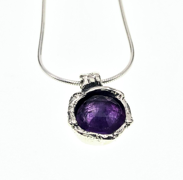 amethyst set in silver necklace
