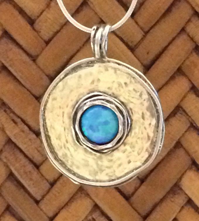 Center opal necklace by Tamir Zuman