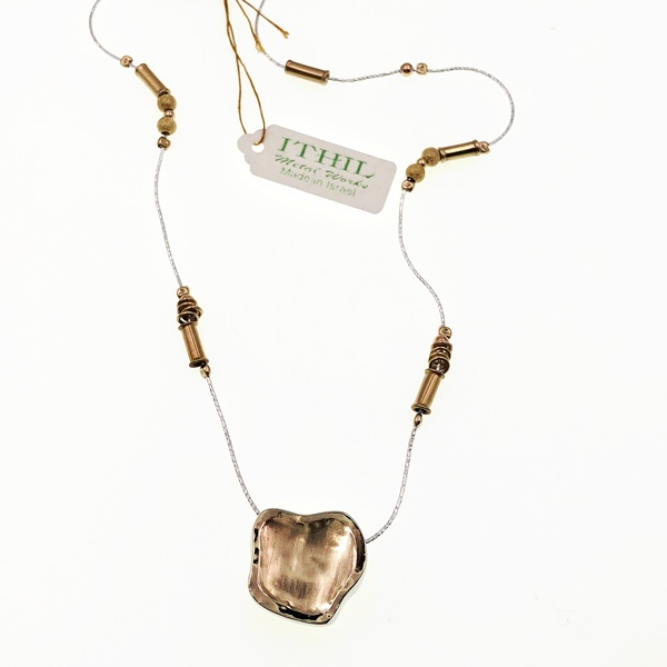 gold and silver necklace by Ithil;