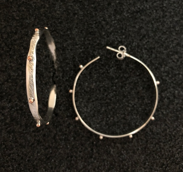 https://eastwindsilver.com/wp-content/uploads/2017/12/silver-hoops-ritual-jewelry-east-wibnd-silver-chatham.jpg
